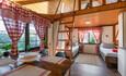 Усадебный комплекс «Бавария», Домик-студия: Первый этаж - 2 кровати, кухонная зона, санузел. На мансардном этаже двуспальная кровать.