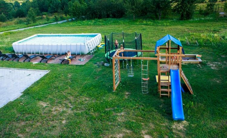 """Агроусадьба """"Поместье Горваль"""", зона отдыха. бассейн. детская площадка."""